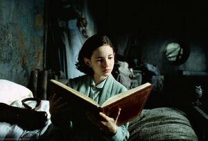 Ofelia reading a storybook