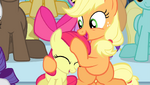 Applejack giving Apple Bloom a noogie S4E24