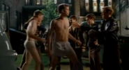 Flat Critters in (Strike! - All I Wanna Do - The Hairy Bird) releasing Schumacher (Paul Nolan) wearing light colored boxers and the photographer (Shawn Ashmore) wearing briefs