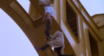 Inspector Gadget and Robogadget trying not to fall from the top of the bridge