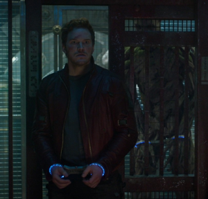 Star-Lord standing up to a thuggish brute who has stolen his mother's music