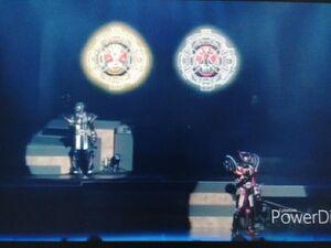 Zi-O II and Geiz DriveArmor are holding their Riderman Ridewatch and X Ridewatch