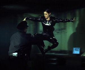 Trinity doing her karate kick