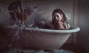 Sirena en bañera