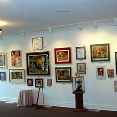 I dipinti originali di zio Paperone i nipotini e Paperino fatti da Carl barks sono esposti tutti insieme