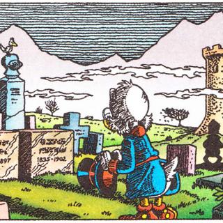 <b>Paperone</b> prega davanti alla tomba dei genitori