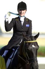 261000 - Equestrian Julie Higgins gold medal 2 - 2000 Sydney medal photo