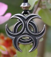 Pewter-tri-knot