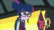 Twilight Sparkle is next to the bus.