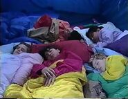 The Backyard Gang sleep in the tent while Barney sings Are You Sleeping