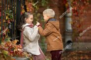 Stock-photo-cute-and-romantic-boy-and-girl-traveling-through-the-autumn-city-russia-savior-on-spilled-blood-704920399