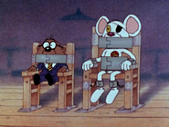 Danger Mouse and Penfold bound and gagged to chairs