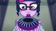 Twilight Sparkle holds her device.