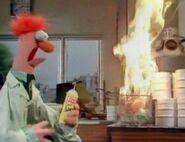 Beaker lights a torch fire on a trashcan
