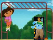 Dora Hanging On Monkey Bar While They Watch