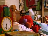 Elmo sleeps in the beginning of Elmo in Grouchland