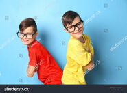 Stock-photo-twin-brothers-in-glasses-on-blue-background-579768949