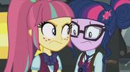 Twilight Sparkle bumps into a student.