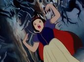 Snow White runs into the spooky forest