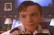 Malcolm as Greg Brady