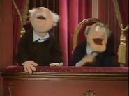 Statler and Waldorf laugh at Fozzie's joke