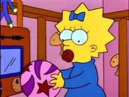 Maggie Simpson with her ball.