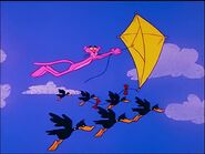 Pink panther flies a kite with ducks flapping