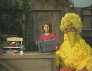Ernestine and Big Bird are asleep as Gina continues to go through Ernie and Bert's photo album