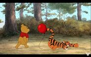 Tigger having a reaction when the red balloon bothers him