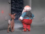 Rudolph and santa in snow storm
