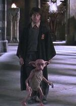 Dobby protecting Harry Potter from Lucius Malfoy