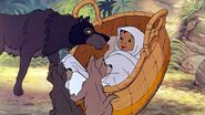 Baby Mowgli with Wolf Family