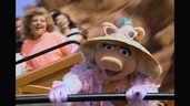 Miss Piggy screams as she rides the Thunder Mountain Railroad roller coaster with Beauregard
