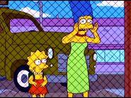 Marge looks worried while Lisa looks sad.