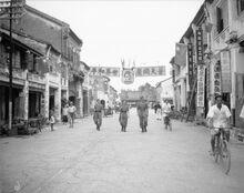 Men of the Royal Air Force Regiment on foot patrol in George Town, Penang