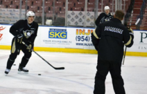 Sid and Geno on the ice, Geno wearing russian K