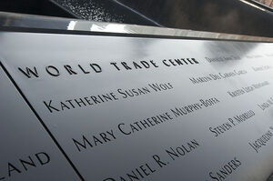 800px-A section of the 9-11 Memorial lists those who lost their lives in the World Trade Center attacks, in New York, N.Y., Nov. 12, 2012 121112-A-QM437-159