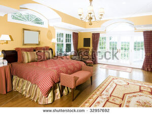Stock-photo-luxurious-master-bedroom-with-king-size-bed-and-beautiful-window-light-32957692