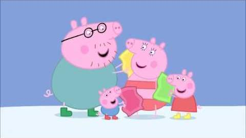 Peppa, George and Daddy Pig rub Mummy Pig with towels