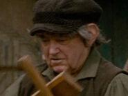 Unknown Extra 12 as Hobbit Carpenter