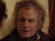 Ian Holm as Bilbo (Old)