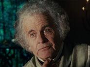 Ian Holm as Bilbo (Aging)