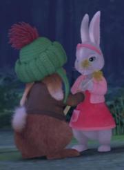 Benjamin offering Lily Dandelions