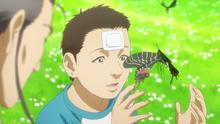 Satoru with a butterfly