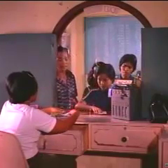 Nora Aunor buying a ticket