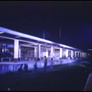 note the lights of the LRT Blumentritt station at the right