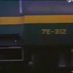 7E-312