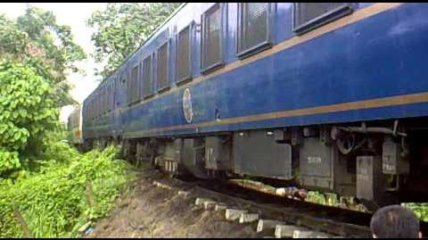 PNR Inaugural Bicol Express Train passing through the eroded embankment at Sipocot