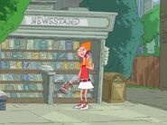 Candace holding a magazine that she grabbed from the newsstand