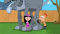 Isabella walks up to Phineas working on the robot dog